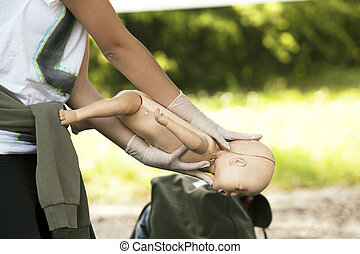 Demonstrating CPR on a infant dummy