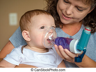 Infant getting breathing treatment from mother while suffering f