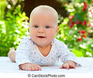 Infant in a summer garden