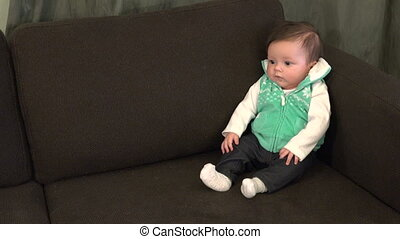 Infant in Couch Corner - An infant propped up in the corner...