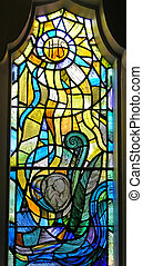 Infant In The Womb - A stained glass window showing an...