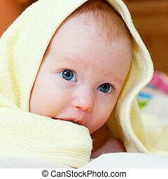 Infant under towel