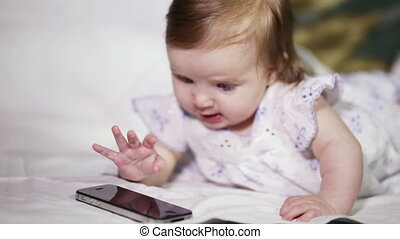 Infant with a smartphone