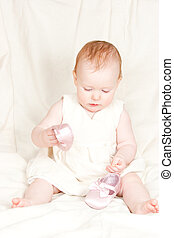 Infant with shoes