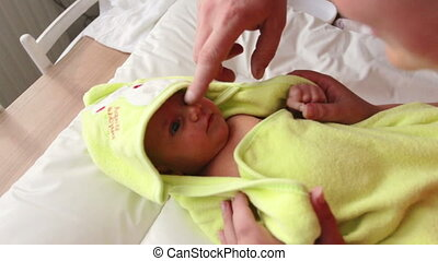 infant wrapped in a towel