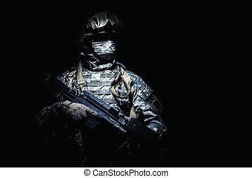 Infantry with machine gun standing in darkness - United...