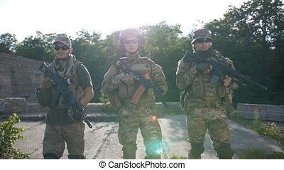 Infantrymen with weapons moving, patrolling area - Portrait...