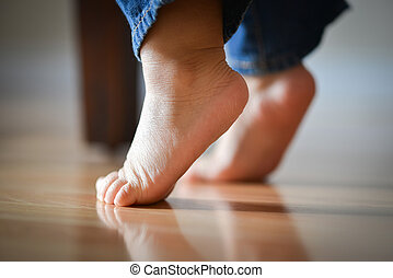 Infant's Precious Feet On Tippy Toes - Innocence Concept -...