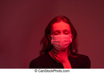 Infected woman feeling pain in throat