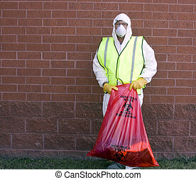 infectious waste removal - man in a protective suit handling...