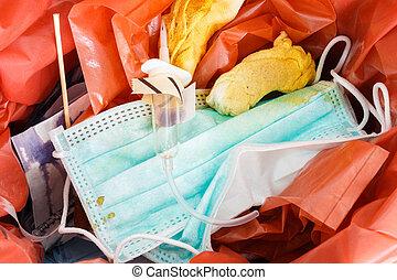 infectious wastes (gauze,mask,iv fluid,syringe in bin)