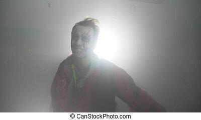 Infernal evil halloween joker clown with a spooky costume...