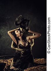 Infernal romance - Seductive gothic girl in embrace of...