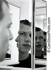Portrait of man, using mirrors (film grain effect).