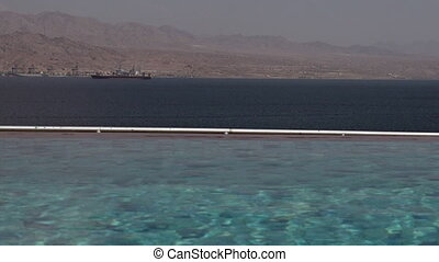 Infinity pool overlooking the landscape and the seascape of the Gulf of Aqaba This video is about Israel 01