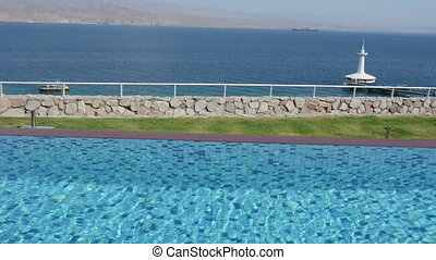 Infinity pool overlooking the Gulf of Aqaba from Eilat,...