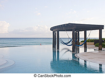 Infinity Pool with Blue Hammocks