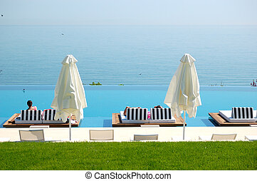 Infinity swimming pool by beach at the modern luxury hotel, Pieria, Greece