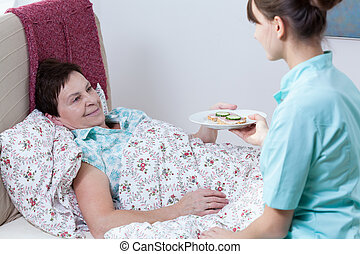 infirmière, donner, patient, repas
