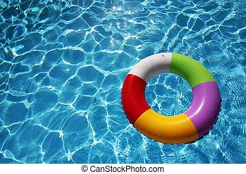 inflável, anel borracha, em, um, bonito, azul, piscina