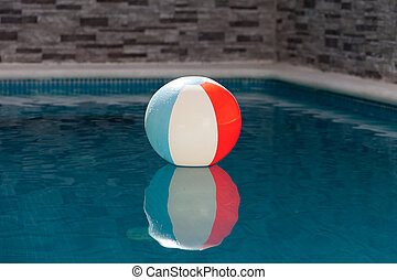 Inflatable ball in a pool