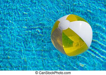 Inflatable beach ball in water