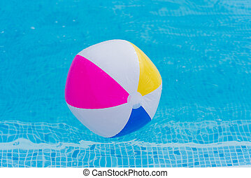 swimming pool beach ball background. Colorful Beach Ball Floating On Surface Of Swimming Pool Water.  Water Close Up Background D