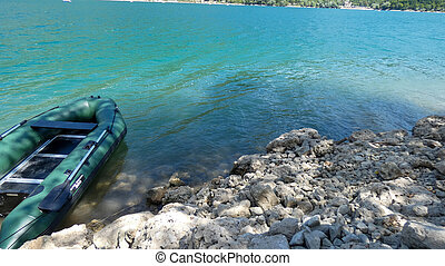 inflatable boat near the shore on Lake Scano, Italy