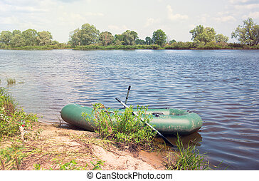 Inflatable boat on the a river near shore