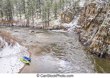 inflatable kayak and packraft on a river - aerial view