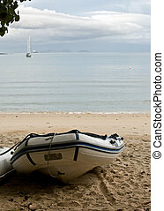 Inflatable rubber boat on beach.