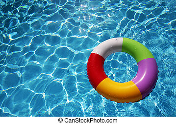Inflatable Rubber Ring in a beautiful blue pool - Inflatable...