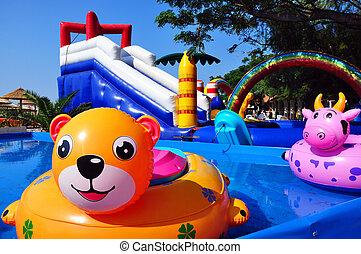 Inflatable toys in children sweeming pool and inflatable...