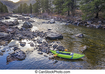 inflatable whitewater kayak on a mountain river - Poudre...