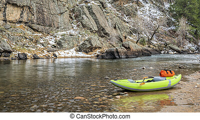 inflatable whitewater kayak on a rocky shore of a mountain ...