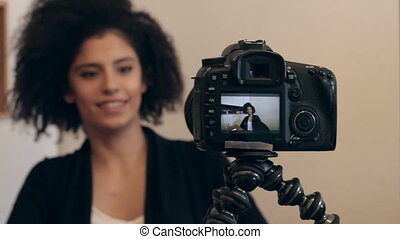 Influencer shooting video blog or vlog - Young female mixed...