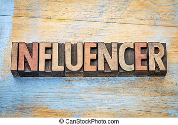 influencer word in wood type - influencer - word abstract in...