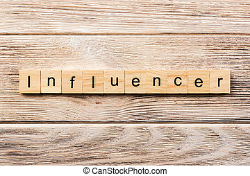 influencer word written on wood block. influencer text on table, concept