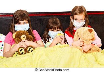 Influenza Among Preschoolers - Sick children in bed wearing...