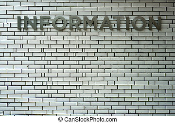 Information - An old, metal information sign affixed to a...