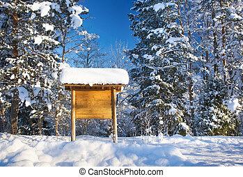 Information sign in winter landscape