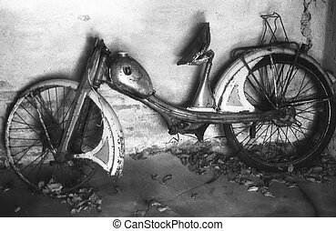 old moped - infrared monochrome image of old moped left in...