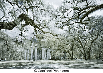 infrared photo of church ruin and live oak trees