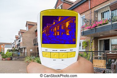 Infrared thermovision image showing thermal insulation of house.
