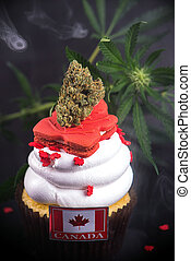 Infused cupcake with cannabis nug, flowers and flag to celebrate candian 150 anniversary