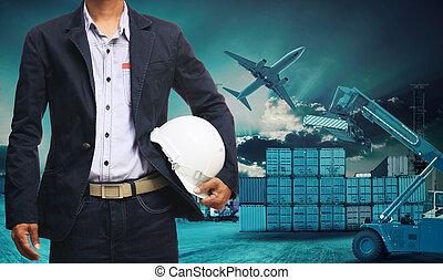 ingénieur, position homme, à, blanc, casque sûreté, contre, beau, sombre, ciel, à, construction bâtiments, site, usage, pour, ingénierie, et, construction, industriel, business