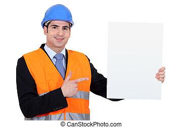 ingenieur, met, een, plank, links, leeg, voor, jouw, boodschap