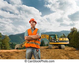 ingenieur, staand, op, gebouw stek