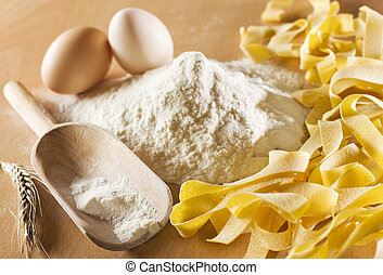 ingredient - Fresh pasta with flour and egg close up
