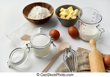ingredients and tools for food cooking on table